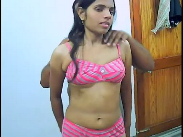 Here Is A Sexy Indian Girl Removing Her Pink Panties And Bra She Has Tiny Tits And Gets Totally Nude Shes With A Fat Indian Guy And She Gets On Her