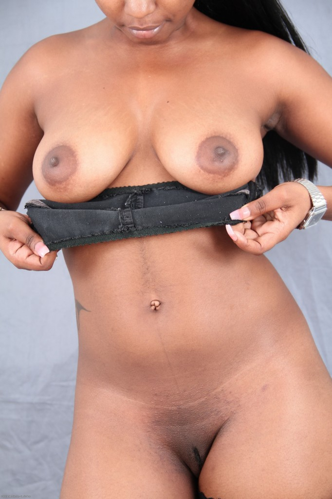 image Dark skinned latina with great tits takes two white dicks in all her holes